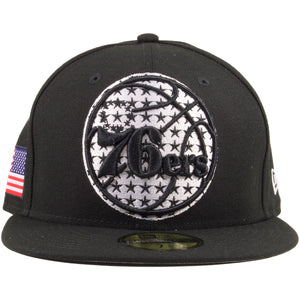 Embroidered on the front of the Philadelphia 76ers Flag Fill Stars and Stripes Black and White fitted is the 76ers logo embroidered in black, behind the logo are black stars embroidered on a white circle