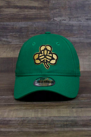 the Boston Celtics 2019 City Series Dad Hat | Irish Green Adjustable Boston Celtics Baseball Cap with Golden Shamrock has a large gold shamrock on the front