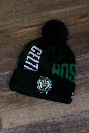 the Boston Celtics 2019 Series Tip Off Black Winter Beanie | Oversized Wordmark Celtics Beanie with Retro Leprechaun Logo has a Celtics logo and oversized letters on the front