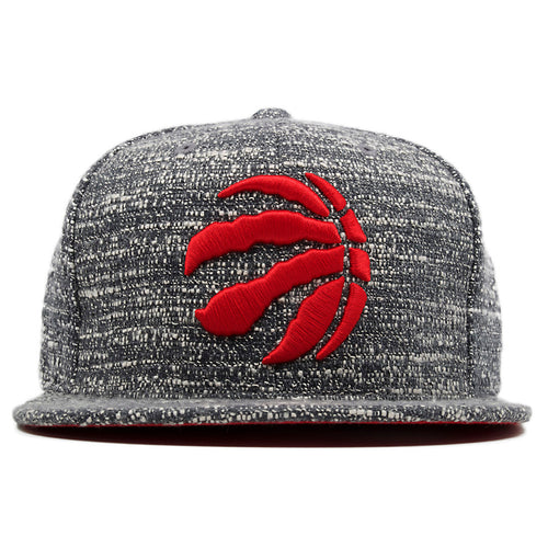 the toronto raptors mitchell and ness marbled grey noise concrete snapback hat has a red toronto raptors logo embroidered on the front