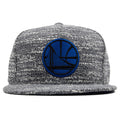 the golden state warriors marbled grey noise snapback  hat is grey with a structured crown and a flat brim
