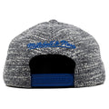 the golden state warriors marbled grey noise snapback hat has a blue mitchell and ness logo embroidered on the back and a blue adjustable snap