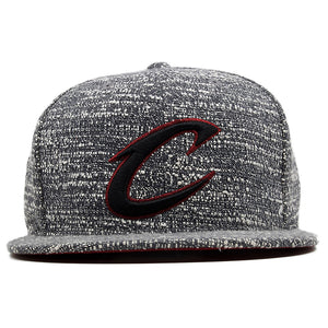 the cleveland cavaliers marbled grey noise concrete snapback hat is heather grey with a black and maroon cleveland cavaliers logo embroidered on the front
