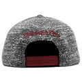 the cleveland cavaliers marbled grey noise snapback hat has a maroon mitchell and ness logo embroidered on the back