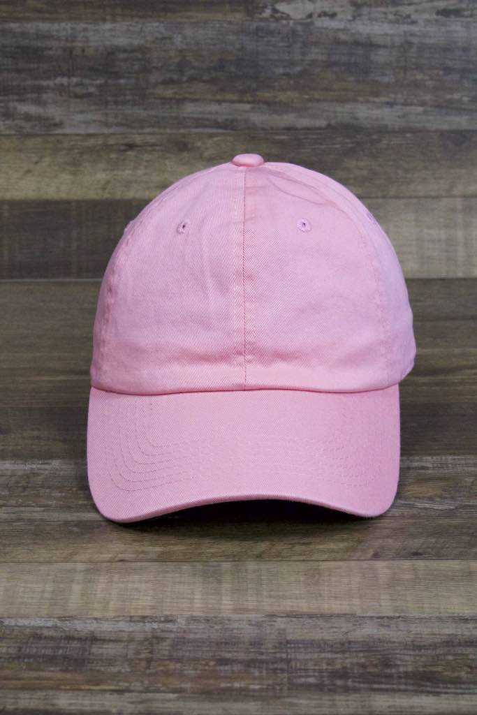 the Plain Pink Adjustable Dad Hat | Logo-Free Unmarked Pink Baseball Cap for Embroidery is made of plain pink twill