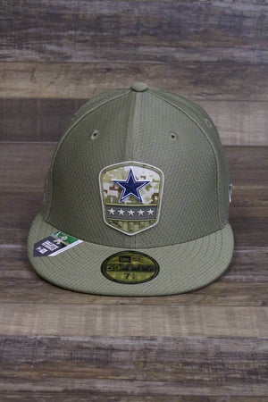 the Dallas Cowboys 2019 Salute To Service Fitted Cap | Olive Green On Field Military Inspired 59Fifty Cowboys Hat has a rubber salute to service patch on the front