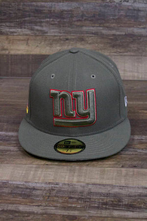 the New York Giants 2017 Salute to Service Fitted Cap | NFL On Field Giants Olive Green Military Inspired Fitted Hat has a NY Giants logo with a red outline on the front