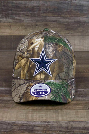 there is a blue star on the front of the Dallas Cowboys Camo Stretch Fit Cap | Realtree Camouflage Flexfit Cowboys Hat with Navy Blue Star