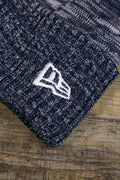 the Dallas Cowboys 2018 On Field Sideline Beanie | Navy Blue Fleece Cowboys Beanie with Diagonal Stripes has a New Era logo on it