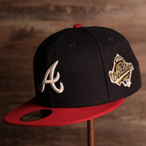 Braves On-Field Grey Bottom Fitted Cap | Atlanta Braves 1995 Game Worn World Series Side Patch Gray Under Brim 59Fifty Fitted Hat the front of this grey bottom fitted has the braves logo with the world series patch on the side
