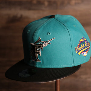 Marlins On-Field Grey Bottom Fitted Cap | Florida Marlins 1997 Game Worn World Series Side Patch Gray Under Brim 59Fifty Fitted Hat the front of this fitted cap has the Marlins retro logo on the front with the world series patch on the side