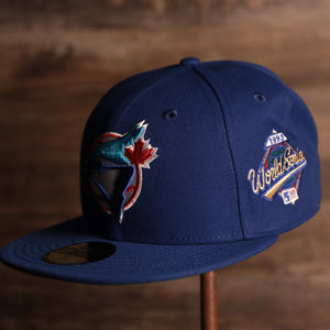 Blue Jays On-Field Green Bottom Fitted Cap | Toronto Blue Jays 1993 Game Worn World Series Side Patch Green Under Brim 59Fifty Fitted Hat the front of this blue jays fitted cap has the blue jays logo with the world series patch on the side of the hat