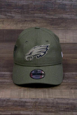the Kids Olive Green Philadelphia Eagles Salute to Service Dad Hat | On Field Salute 9Twenty Hat Youth Size has a large Eagle logo on the front