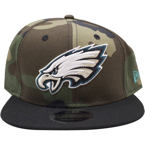the Philadelphia Eagles woodland camouflage snapback hat has a camouflage crown and a black brim. On the front of the cap the Philadelphia Eagles logo is embroidered on the front.