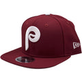 the philadelphia phillies cooperstown maroon snapback hat has a high maroon crown and a flat maroon brim