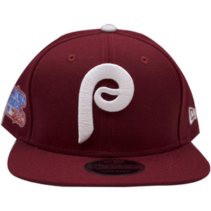 the Philadelphia Phillies cooperstown maroon 1980 World Serires snapback hat is solid maroon with a high crown and flat brim