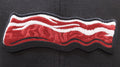 the bacon logo of the lehigh valley iron pigs is brown and white, and says the word iron pigs within the bacon