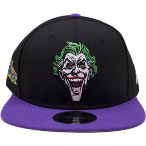 the joker dc comics snapback hat has a black crown and a purple brim