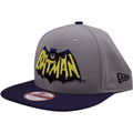 the retro batman dc comics snapback hat has a gray crown and a navy blue brim