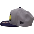 the batman vintage lettering snapback hat has a high gray crown and a flat navy blue brim