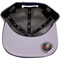 the dc comics batman 950 snapback hat has a gray underbrim