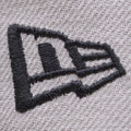 the new era logo embroidered on the gray on navy blue batman dc comics snapback hat is embroidered in navy blue