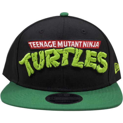 on the front of the teenage mutant ninja turtles snapback hat there is a teenage mutant ninja turtles wordmark logo embroidered in red white black and green