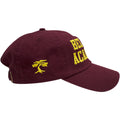the maroon bel air academy dad hat has a yellow foot clan bonsai tree embroidered on the wearer's right side