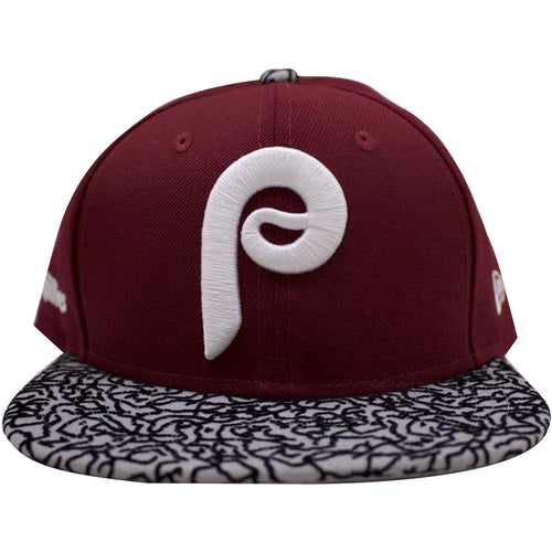 the philadelphia phillies cooperstown vintage throwback snapback hat has a maroon crown and a jordan print brim