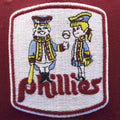 the 1970s logo for philadelphia phillies cooperstown snapback hat has two people in 18th century clothing playing baseball