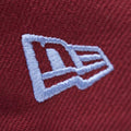 the new era logo embroidered on the 1970 vintage Philadelphia Phillies throwback snapback hat is light blue
