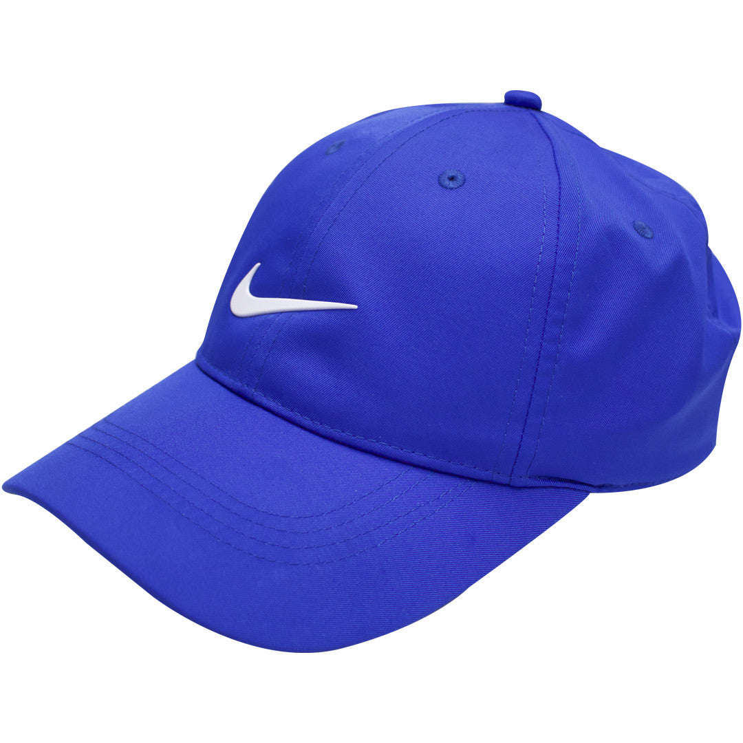 117a2eb531ec8 ... the royal blue nike swoosh golf dri-fit ball cap has a blue brim and ...