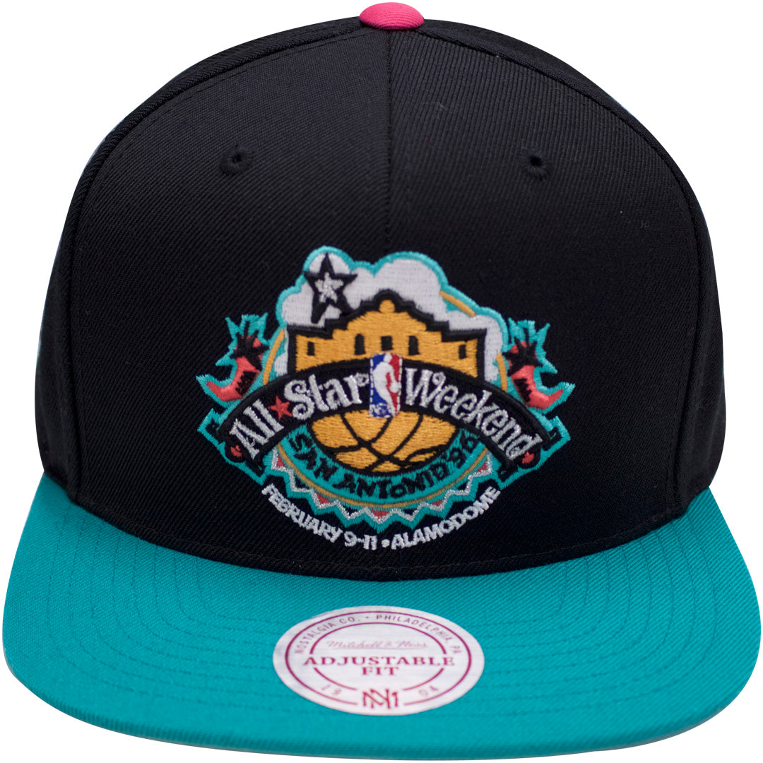 cdffce118862 The vintage nba mitchell and ness snapback hat has a black crown and a teal  brim