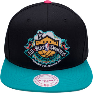 The vintage nba mitchell and ness snapback hat has a black crown and a teal brim