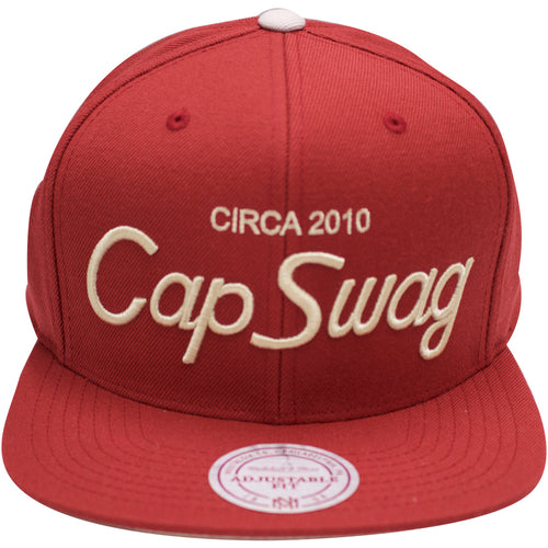 the cap swag x mitchell and ness snapback hat is maroon with tan embroidery on the front