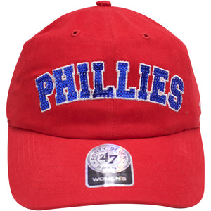 the phillies red women baseball hat is red and has the word phillies in blue rhinestone