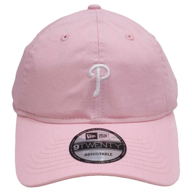 the pink dad hat is solid pink with a white logo on the front