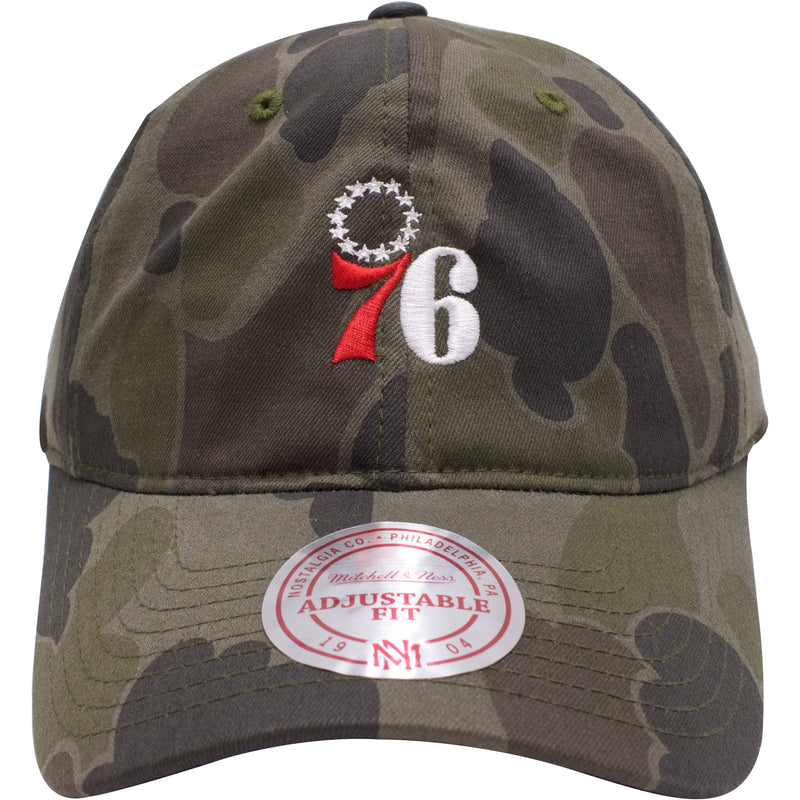 the philadelphia 76ers woodland camouflage dad hat has a soft crown and a bent brim