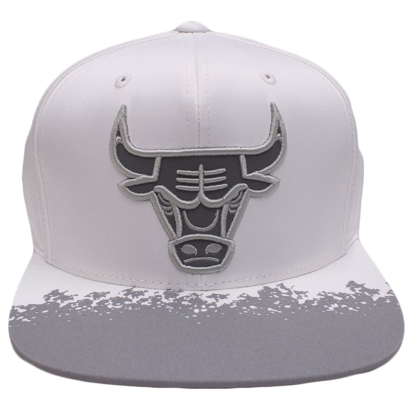 the white chicago bulls reflective lava snapback hat is white with a gray reflective chicago bulls logo on the front