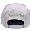 on the back of the chicago bulls white reflective lava has a silver mitchell and ness logo