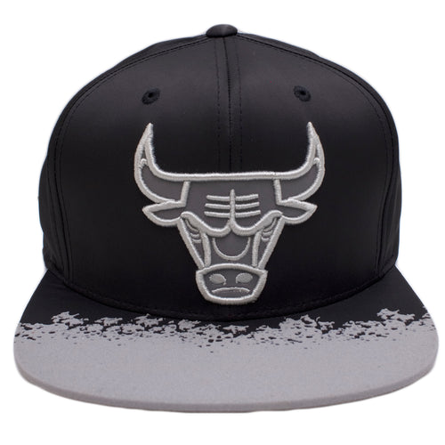 the chicago bulls reflective lava snapback hat is black with a gray reflective chicago bulls logo