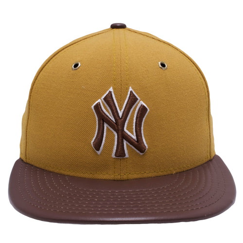 the wheat timb matching yankees fitted cap has a tan crown and a brown brim with a brown yankees logo embroidered on the front