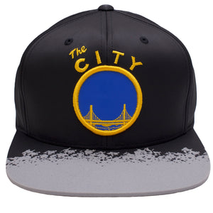 on the front of the golden state warriors reflective lava snapback hat, there is a vintage warriors logo embroidered on the front in blue and gold
