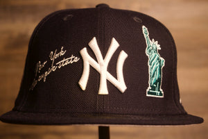 Grey Bottom Fitted Hat | 59FIFTY Gray under brim Yankees Fitted Cap | Multi City Patch | New York Yankees Fitted the front of this yankees grey bottom is the yankees logo, the statue of liberty, and the city's nickname