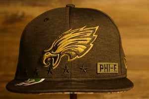 Eagles Snapback | Philadelphia Eagles 2020 Salute To Service Snap Cap | Eagles Army Hat | Camo Bottom | Black front of the eagles salute to service 2020 hat