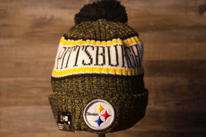Steelers Beanie | Pittsburgh Steelers 2018 On-Field Beanie | Steelers Winter Hat this steelers on field beanie is black and yellow with a white and yellow strip across the front with the city's name inside of it