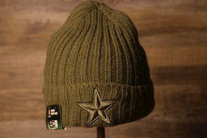 Cowboys Youth Beanie | Dallas Cowboys 2017 Salute To Service Youth Beanie this cowboys salute to service 2017 youth beanie has the cowboys logo in olive green with a blue outline on the front cuff