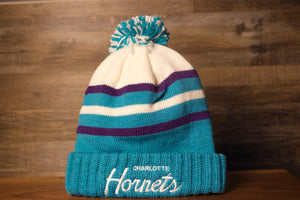 Hornets Beanie | Charlotte Hornets Retro Teal Beanie the front is teal, purple, and white with a teal and white pom
