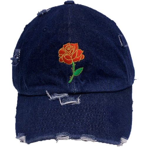 the rose bud distressed rose flower denim distressed dad hat is denim with a red, green, and gold
