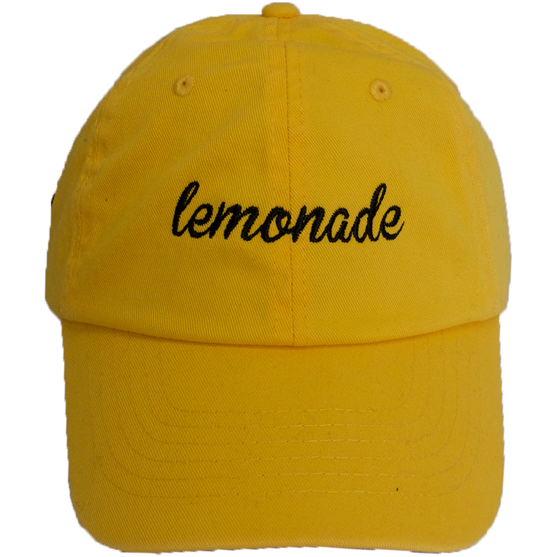 on the front of the beyonce lemonade dad hat, it says lemonade in black script